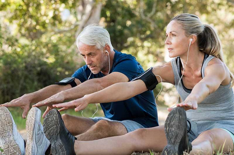 Couple at a park stretching